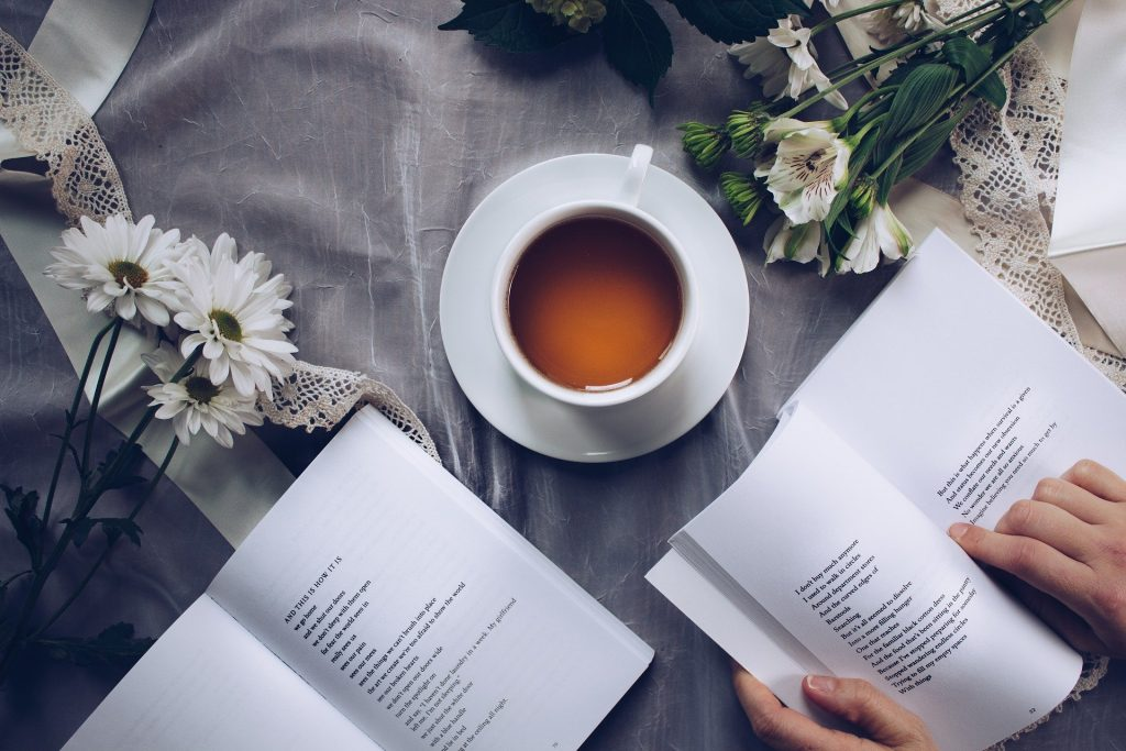 cup of tea, books, flowers