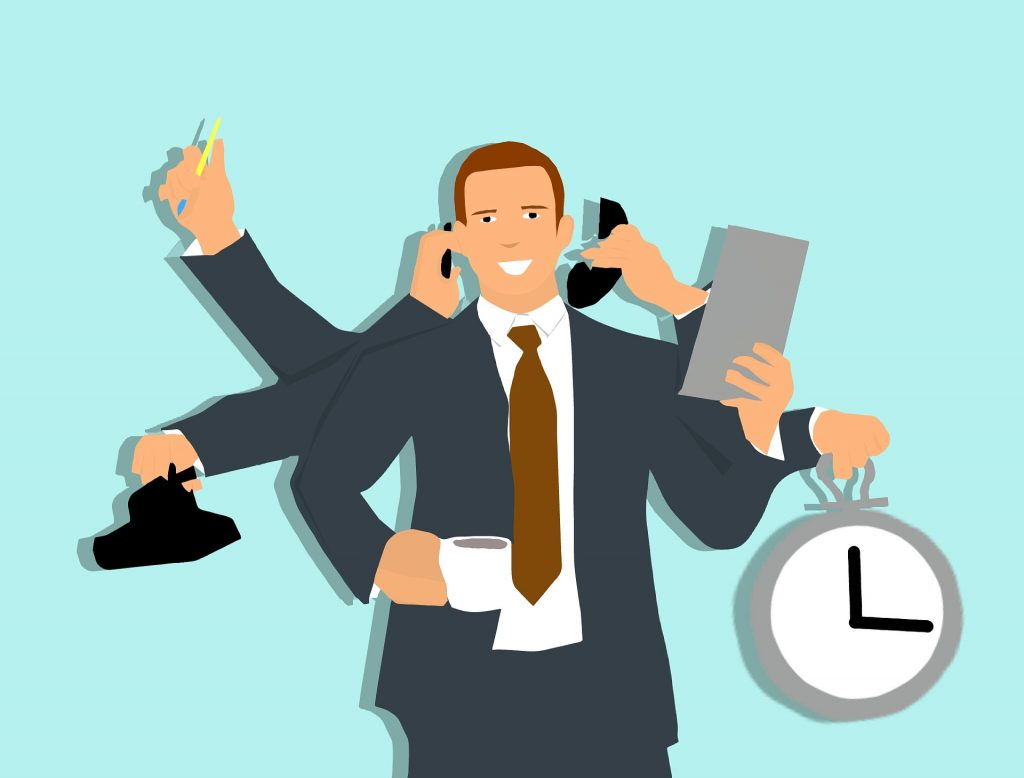 A manager, holding clock,files, tea, lunch, phones and pen