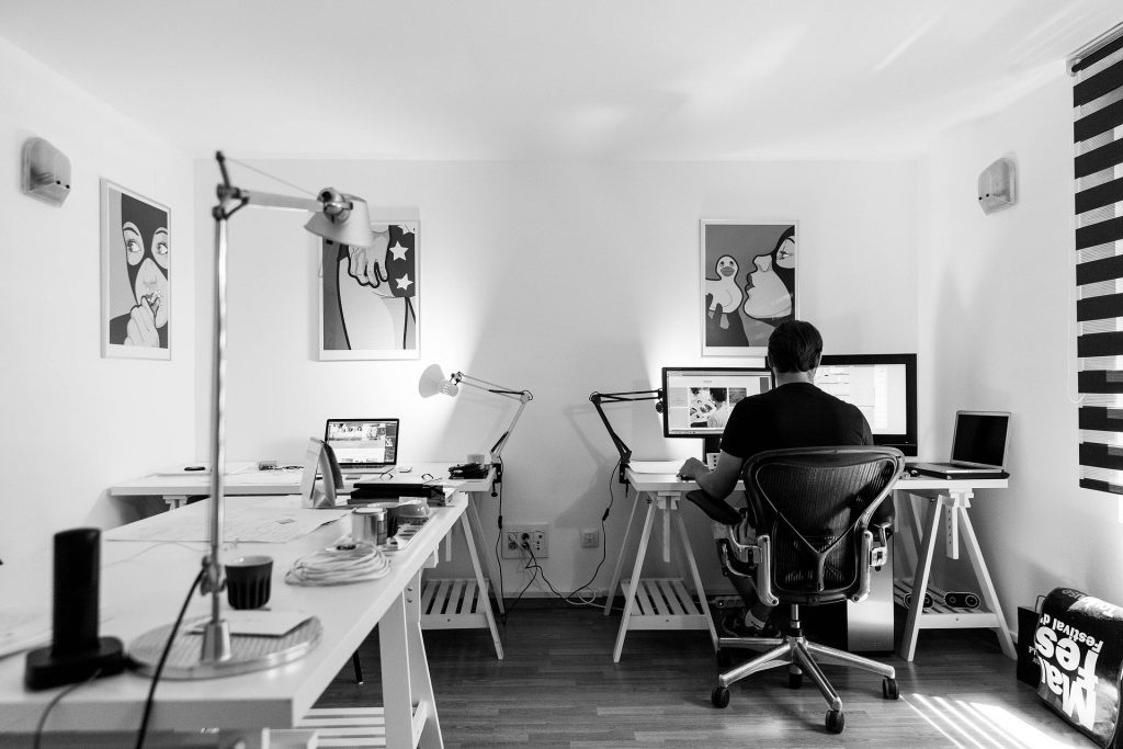 Work from home, a man on laptop web designing