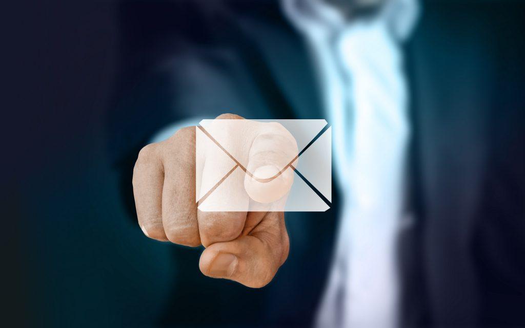A businessman clicking a email.