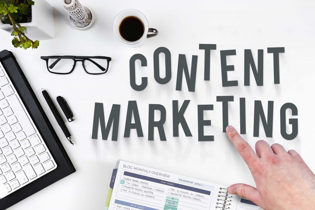 Content marketing, notepad, laptop, pen