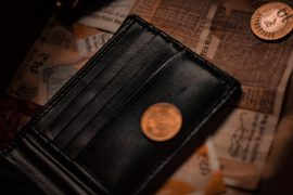 A wallet with money and coins